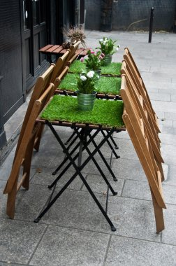 Restaurant terrace with artificial grass on the table