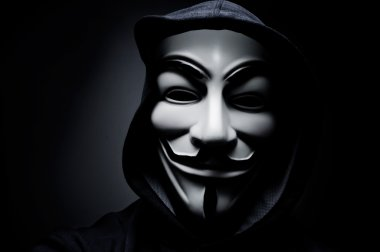 Photo of man wearing Vendetta mask. This mask is a well-known symbol for the online hacktivist group Anonymous. Also used by protesters.