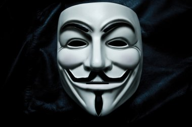 Paris - France - 18 January 2015 - Vendetta mask on black background . This mask is a well-known symbol for the online hacktivist group Anonymous