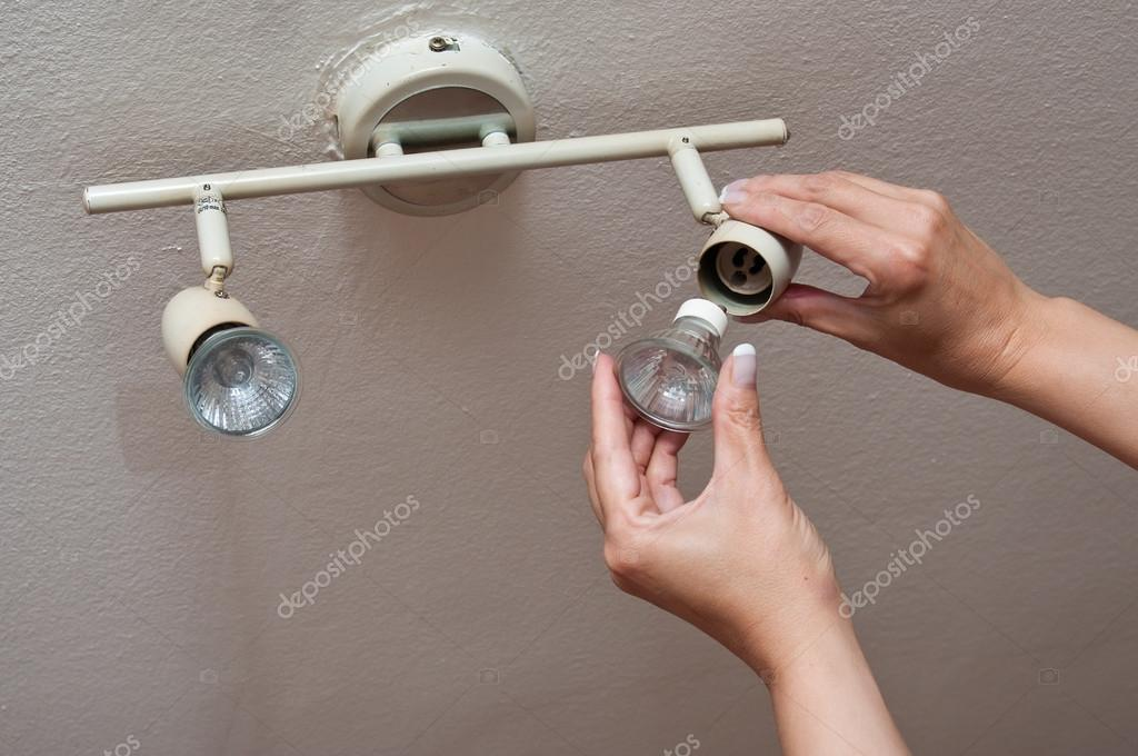 Woman changing a Light Bulb