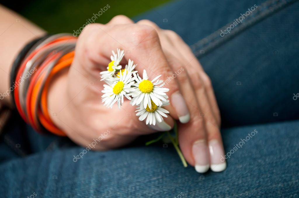 Woman with  bouquet of daisies in  hand