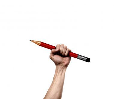 Hand holding pencil as a symbol of  shooting cartoon artists in France