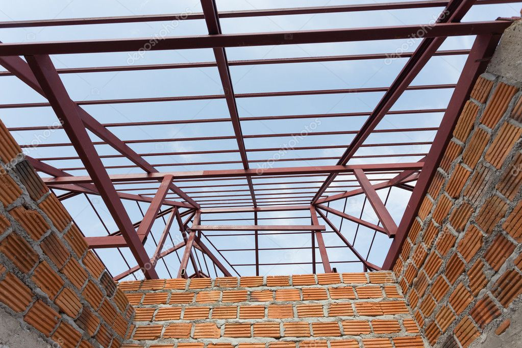 Structural Steel Beam On Roof And Brick Wall Of Building Stock