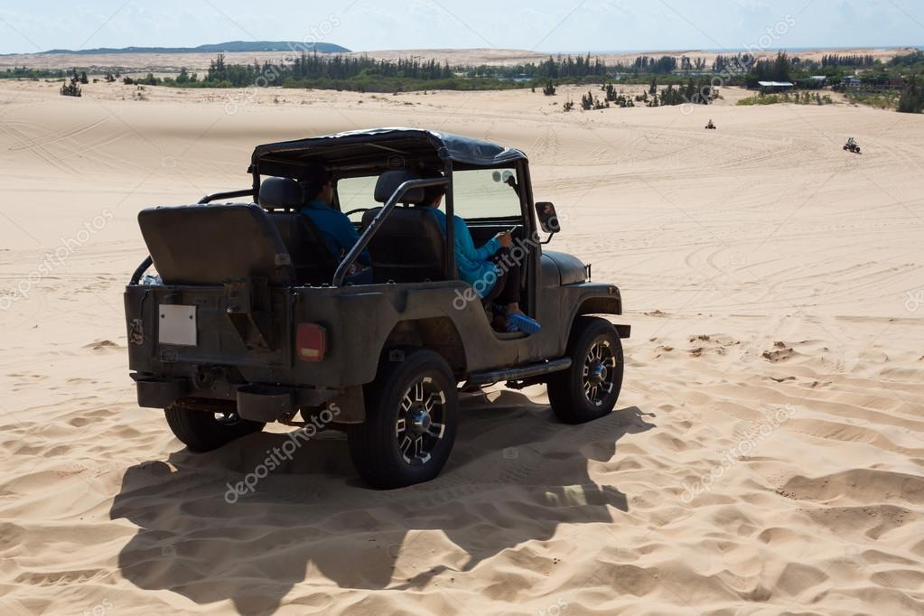 off road car vehicle in white sand dune desert at Mui Ne
