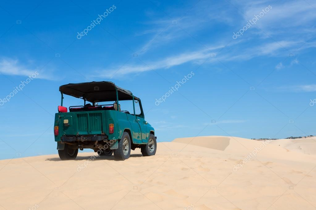 off road car vehicle in white sand dune desert at Mui Ne