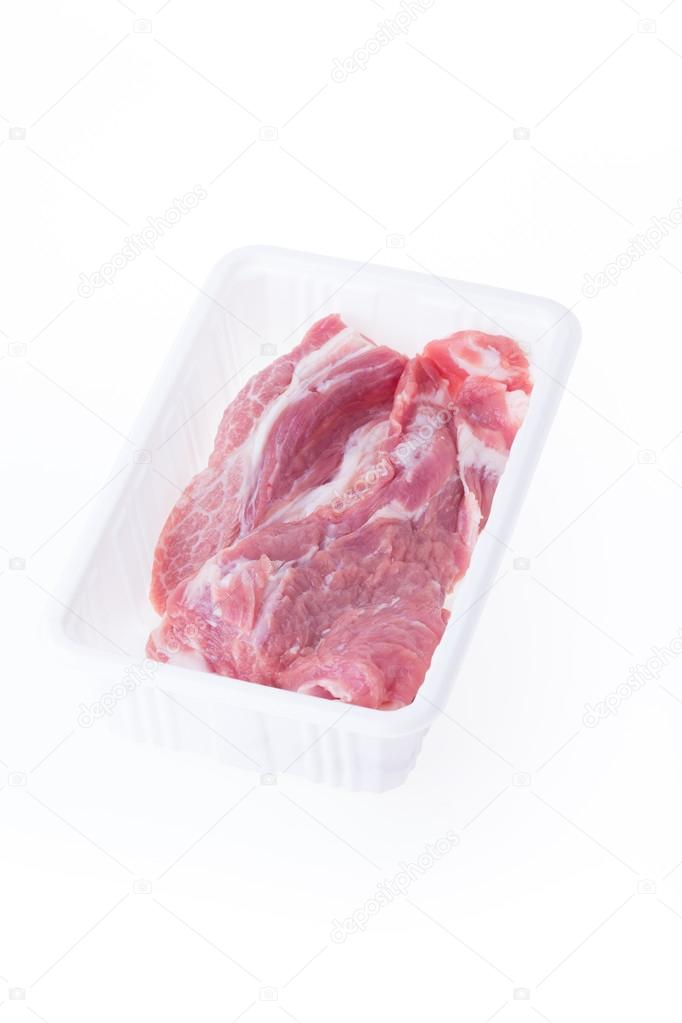 raw pork in plastic box package isolated on white background