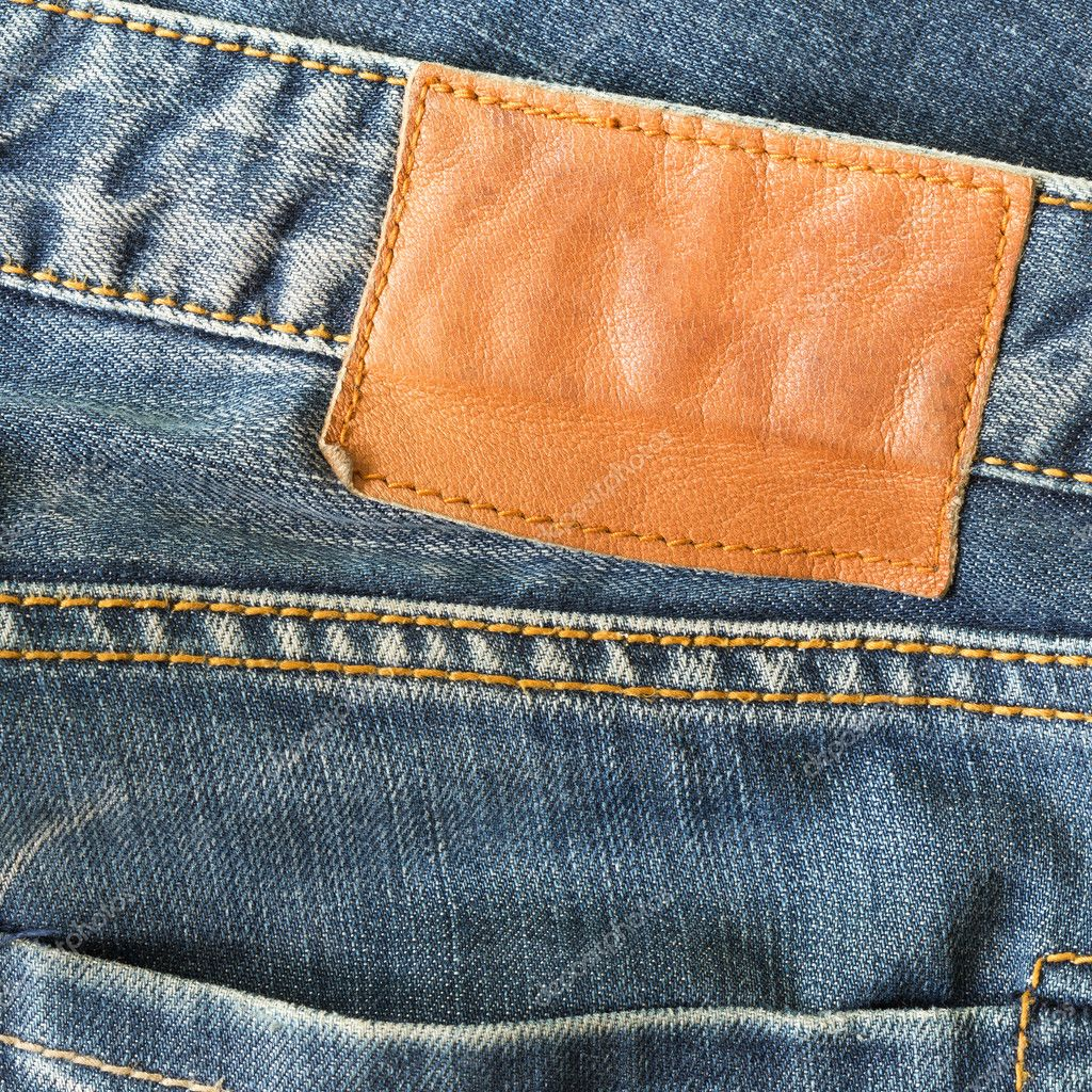 brown leather tag on blue jeans stock photo sutichak 73727747