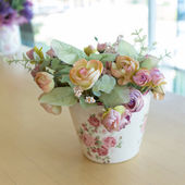 Photo Flowers vase decoupage decorated on wooden table at living room