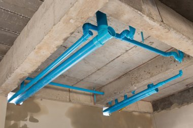 water pipes pvc plumbing under cement ceiling of second floor