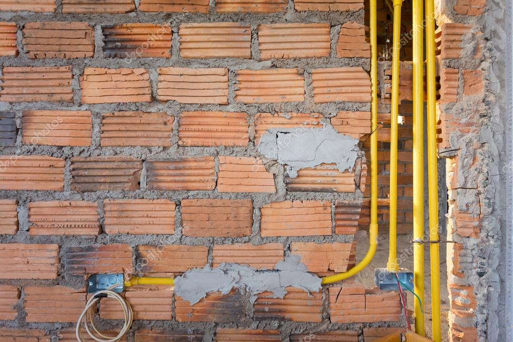 brick wall in residential house building construction site stock rh depositphotos com Wall Switch Wiring Diagram wiring through brick wall