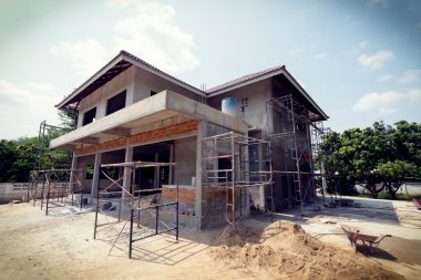 building residential construction house with scaffold steel