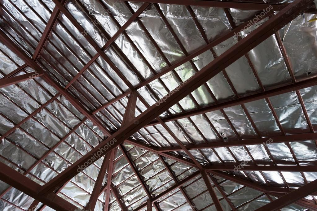 roof with steel beam and silver foil insulation heat on ceiling
