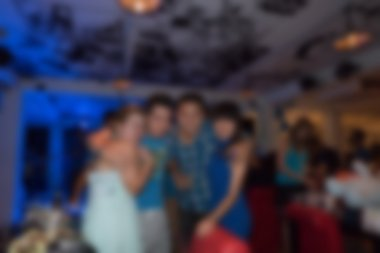 group of young people having joyful dancing in nightclub party