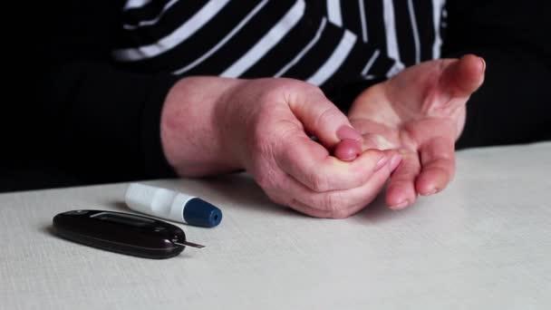 Woman Measures the Blood Sugar Level. Diabetes.