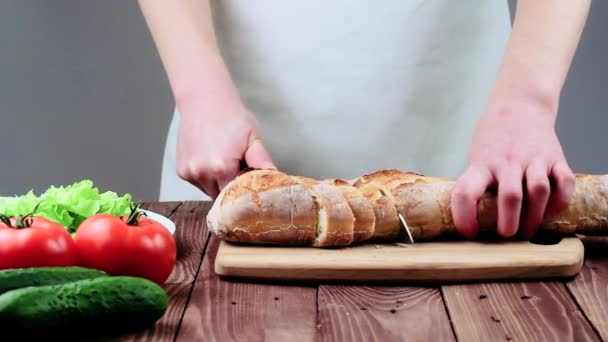 Woman Cut Fresh Bread Knife. on the Table Are the Vegetables: Tomatoes, Cucumbers and Lettuce. the Restaurants Cuisine.