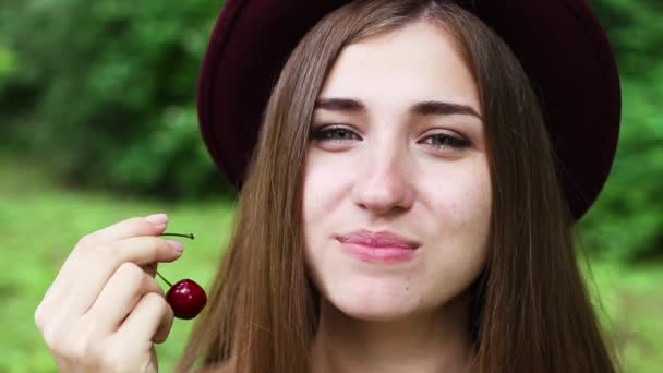 Beautiful Girl in the Hat Eating Cherry.