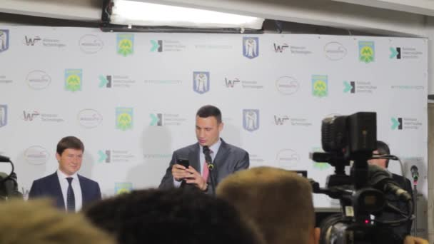 Vitali Klitschko on the phone to his brother Wladimir Klitschko  Press  conference in Kiev underground
