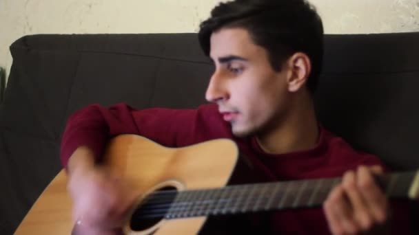 Handsome Guy Plays Guitar And Sings A Song Stock Video 97555886