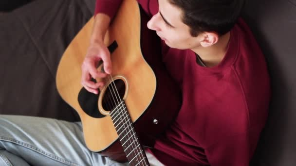 Beautiful And Cute Musician Playing Acoustic Guitar Top View Stock Video 97558444