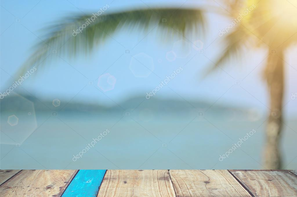 Blur palm tree on tropical beach background.