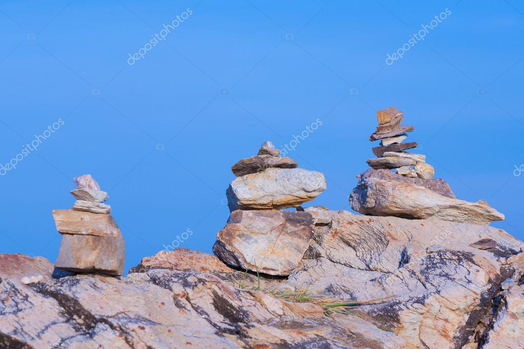 Stack stones with clear blue sky background