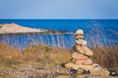 Rock stack with ocean skyline background, natural landscape