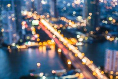 Blurred bokeh lights aerial view city bridge cross river night view