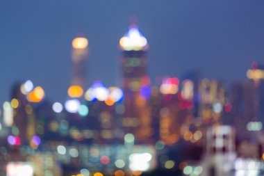 Blurred multiple colour lights night view, city office building background