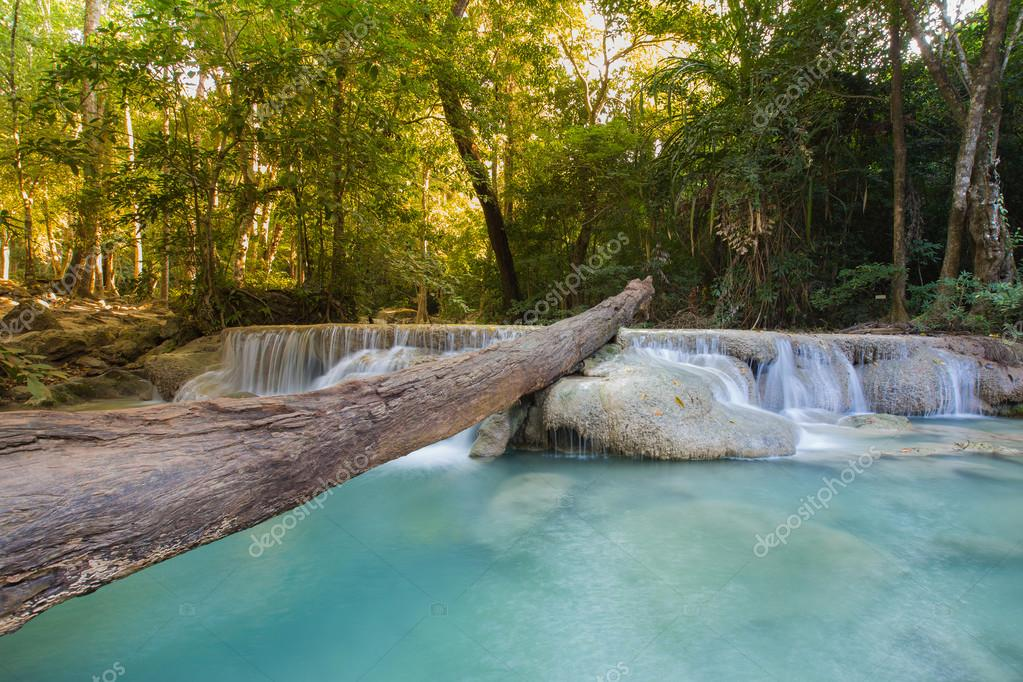 Фотообои Natural blue stream waterfall in deep forest
