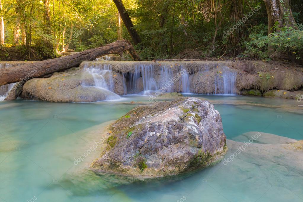 Фотообои Deep tropical blue stream waterfalls in natural forest background