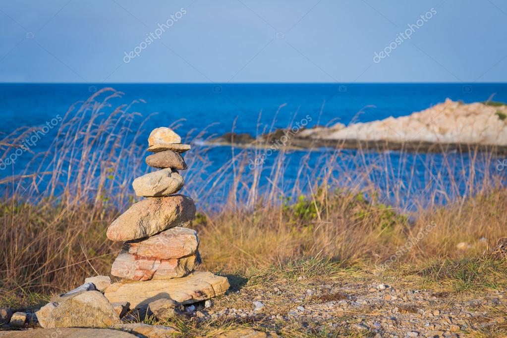 Stone stack over seacoast background