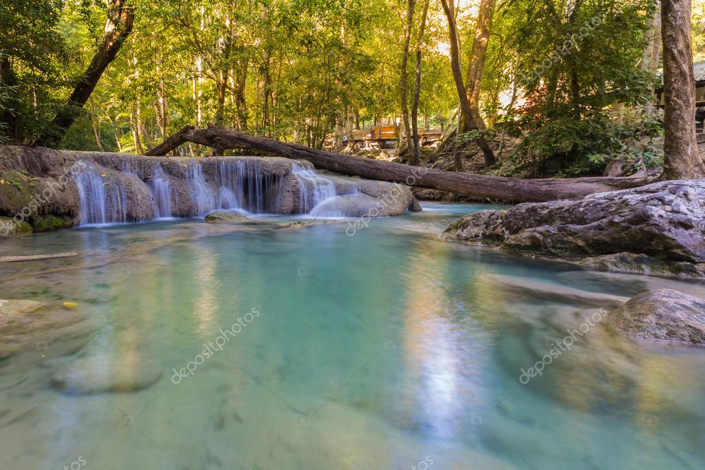 Фотообои Blue stream waterfall locate in deep forest jungle