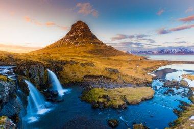 Water falls at Kirkjufell mountain