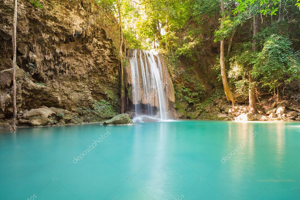 Blue stream water falls locate in deep forest jungle