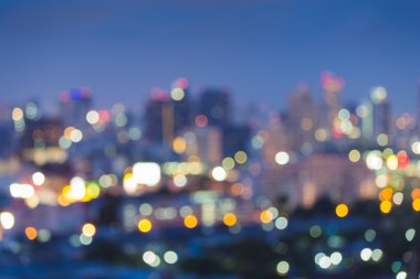 Abstract blur bokeh of city skyline during twilight