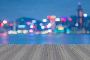 Opening wooden floor with Hong Kong blurred bokeh city lights