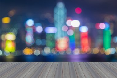 Wooden platform with abstract blurred bokeh Hong Kong city lights skyline, twilight background