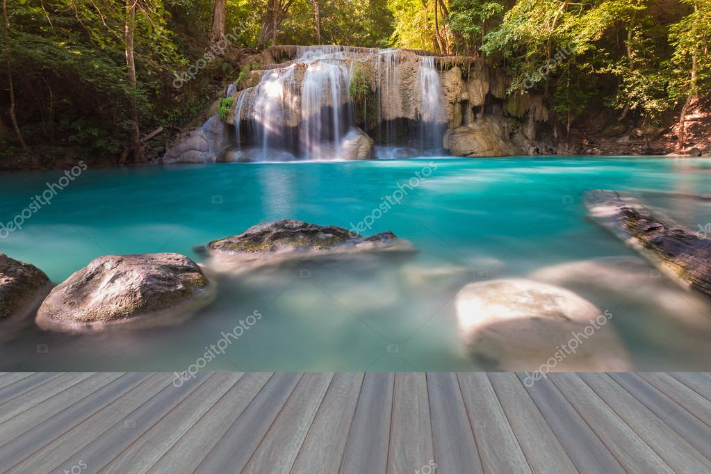 Opening wooden floor, Deep forest waterfall in national park
