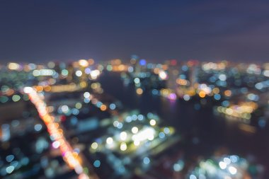 Abstract blurred bokeh lights city aerial view at night