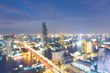 Abstract blurred bokeh lights city aerial view with city bridge cross river at night