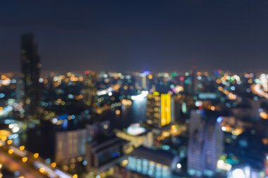 Abstract blurred bokeh light cityscape nigh aerial view