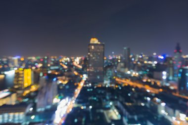 Abstract blurred bokeh lights, aerial view of city downtown at night