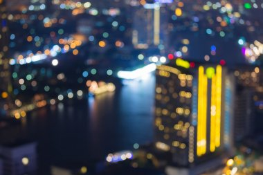 Abstract blurred bokeh lights, city aerial view with river