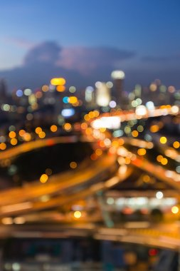 Aerial view city road intersection during twilight, blurred bokeh light background