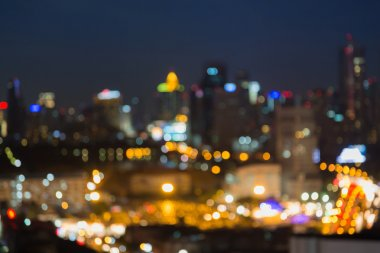 Defocused city downtown lights at night