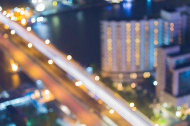 Abstract blurred bokeh light, aerial view of city bridge at night