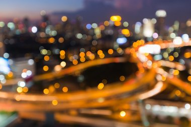 Aerial view of blurred bokeh city road interchanged night view, abstract background