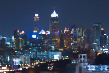 Night blurred bokeh city office building lights, abstract background