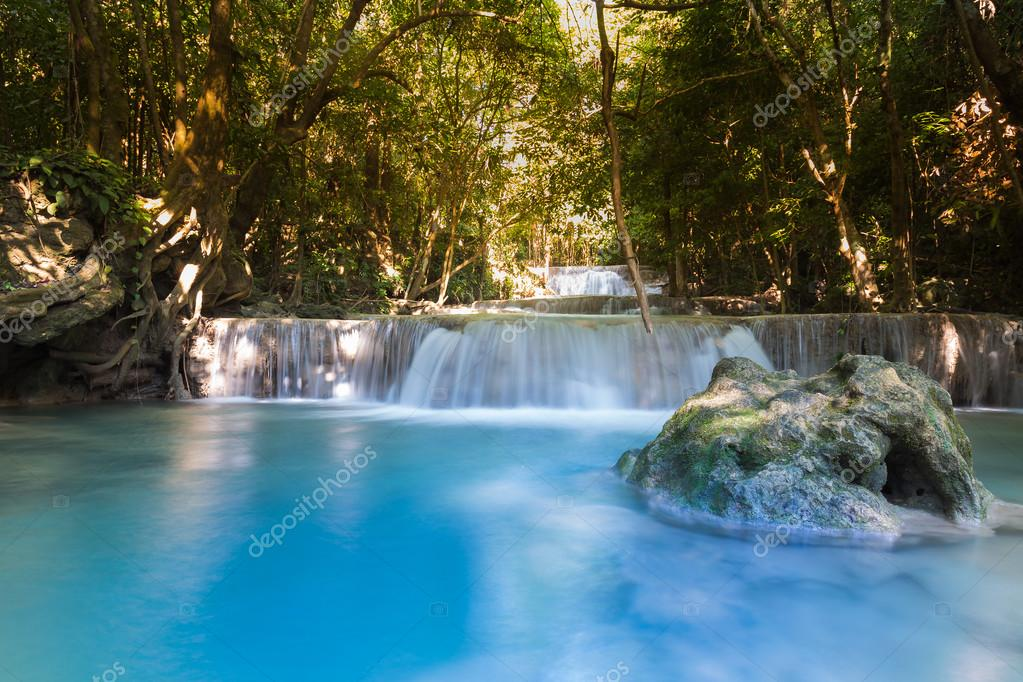 Фотообои Blue stream water falls in deep forest