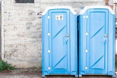 Two blue portable toilet.